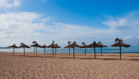 Parasols on the beach Stock Photos