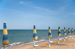 Parasols at the beach Stock Image