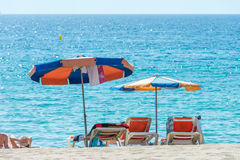 Parasols on the beach Stock Photography