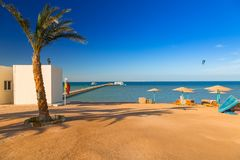 Parasols on the beach of Red Sea in Hurghada. Egypt Royalty Free Stock Photo