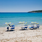 Parasols on beach, Sardinia Stock Photo