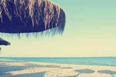 Parasols on the beach in summer, retro/vintage Royalty Free Stock Images