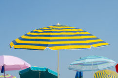 Parasols on the beach on sunny summer day Royalty Free Stock Image