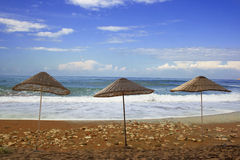 Parasols on the beach Royalty Free Stock Photos