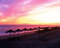 Parasols on beach, Torrox Costa, Spain. Royalty Free Stock Photos