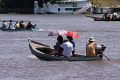 Parasols in the boat. Small boat with people in the river Amazônas - Brazil Royalty Free Stock Images