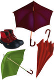 Parasols and boots Royalty Free Stock Images