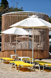Parasols and deckchairs on the beach Stock Photography