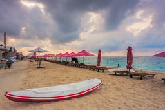 Parasols on empty beach at Sunrise in Bali Stock Photography