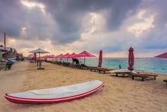 Parasols on empty beach at Sunrise in Bali. Parasols on empty beach in Bali, Indonesia Stock Photography