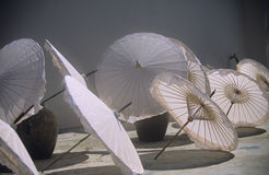 Parasols, fine art. White colored parasols in bright sunlight in a Thai village royalty free stock photo
