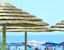 Parasols made with bamboo and straw in the luxurious resort by t Stock Photography