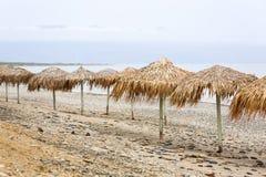 Parasols at Maleme beach on Crete. Tropical parasols at Maleme beach on Crete, Greece Royalty Free Stock Photo