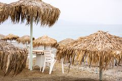 Parasols at Maleme beach on Crete. Tropical parasols at Maleme beach on Crete, Greece Royalty Free Stock Images