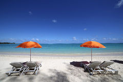 Parasols on Mont-Choisy beach, Mauritius island Stock Photos