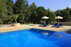 Parasols by the pool Porto Carras Meliton. Royalty Free Stock Image