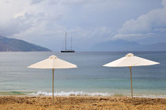 Parasols and sailboat Stock Photo