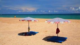 Parasols on sand at Karon beach in Phuket Royalty Free Stock Photo