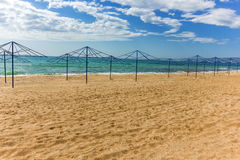 Parasols on the sandy beach. And blue sky with clouds Royalty Free Stock Photo