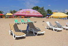 Parasols on the sandy beach Royalty Free Stock Photo