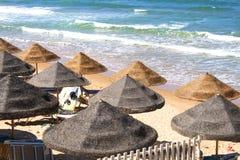 Parasols on a sandy beach in Trappeto, Sicily, Ciammarita di Trappeto Stock Image
