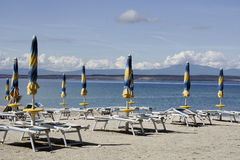 Parasols and sun beds Stock Photography