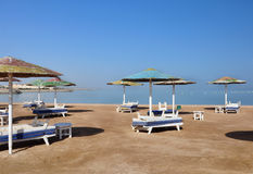 Parasols and sun loungers on the beach in Egypt. Nobody royalty free stock image