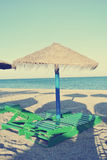 Parasols and sun loungers on the beach, retro/vintage Stock Photography