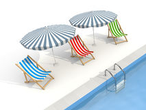 Parasols and sun loungers are near the pool Royalty Free Stock Image