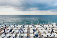 Parasols and sunbeds. A picture of an empty morning beach in Nice, Cote d' Azur, France Royalty Free Stock Photos