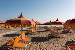 Parasols and sunbeds in Torre Pedrera near Rimini in Italy royalty free stock image