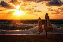 Parasols at sunset in the Mediterranean resort Royalty Free Stock Photos