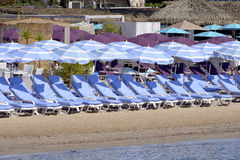 Parasols and transats on beach Royalty Free Stock Images