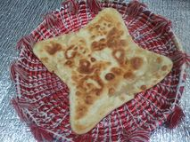 Paratha Oily bread served in changair. As Pakistani traditional breakfast Royalty Free Stock Photos