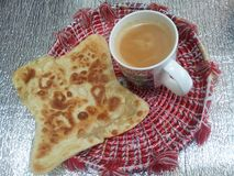 Paratha Oily bread with tea cup served in changair stock image