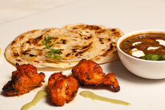 Paratha with paneer and kebab. Stock Image