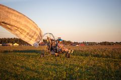 Paratrayke flight, paraglider in the sky at sunset. stock photography