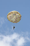 Paratrooper. Flying over cloudy sky Royalty Free Stock Photography