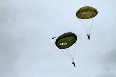 Paratrooper airshow. Paratrooper on the airshow hanging from a round parachute Royalty Free Stock Images