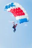 Paratrooper girl descends Stock Photo