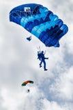 Paratrooper man descends Stock Images