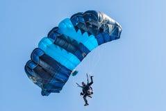 Paratrooper man descends Stock Image