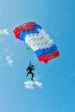 Paratrooper man descends Stock Photography