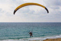 Paratrooper parachute landing on the beach near the Mediteranian Stock Image