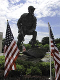 Paratrooper statue. Memorial paratrooper statue surrounded by flags at the Airborne & Special Operations Museum in Fayetteville, NC, USA Stock Photos