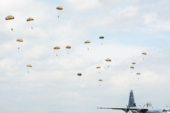 Paratroopers in the air during airshow Royalty Free Stock Photography