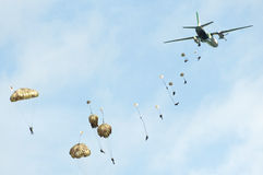 Paratroopers in the air during airshow. PIESTANY, SLOVAKIA - MAY 29: paratroopers jump out of An-26 aircraft in low level height during airshow in Piestany royalty free stock photography