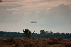 Paratroopers drop during the 72th commemoration of operation Market Garden Stock Images