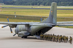 Paratroopers entering plane Stock Images