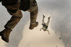 Paratroopers jumping  Stock Photos